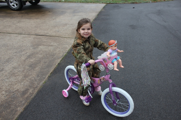 Ammon, new bicycle, and coveralls Christmas Day 2012