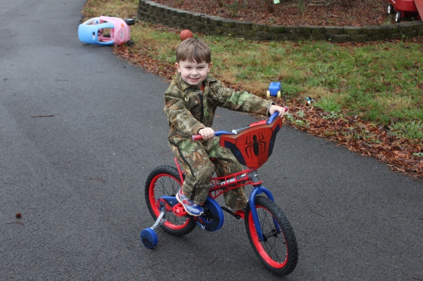 Carter, his new bicycle, and coveralls Christmas Day 2012