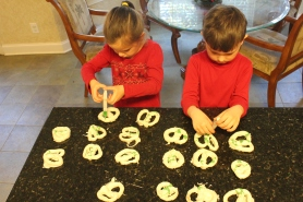 With Daddy H's syringe creation, making green stripes on the Pretzels
