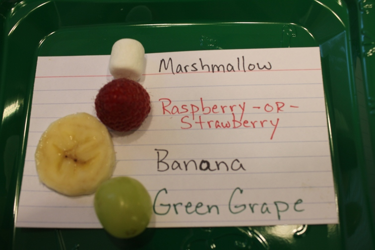 From Bottom to Top: Green Grape, Banana coin, Raspberry or Strawberry, Mini-Marshmallow