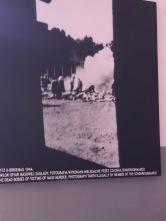 An illegal photo taken of prisoners taking care of burning bodies.